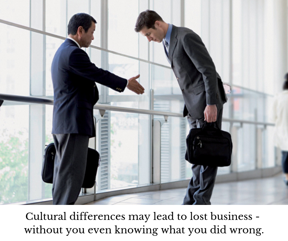 Two businessmen, one Asian, the other 'Western,' both attempting to adapt to the other's culture.
